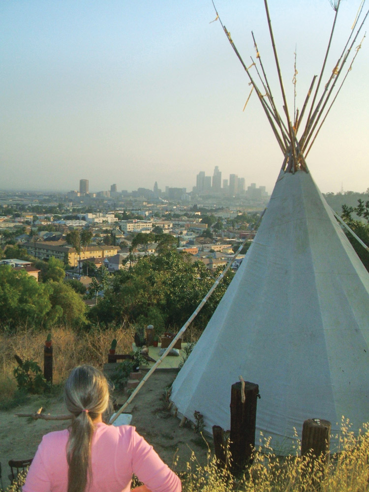 A tepee in a hilly, urban backyard of Los Angeles.