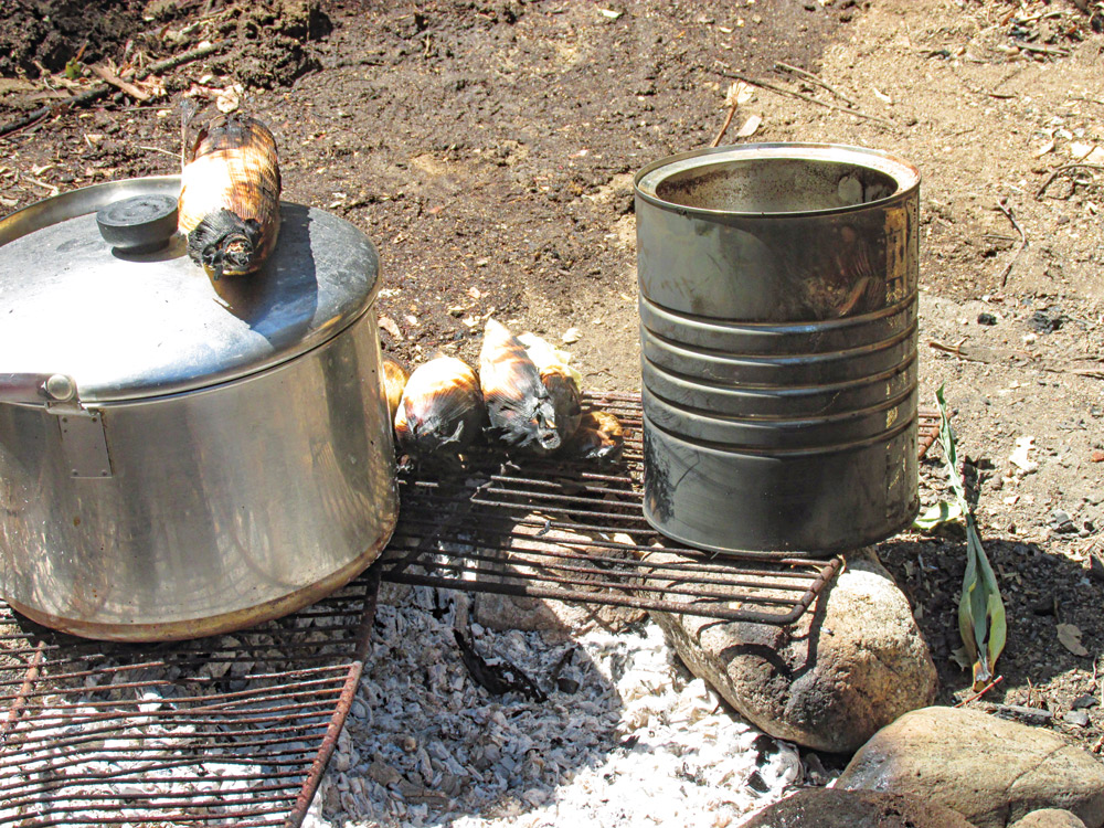 Cooking on rocks is easy and inexpensive to set up in a backyard camp.