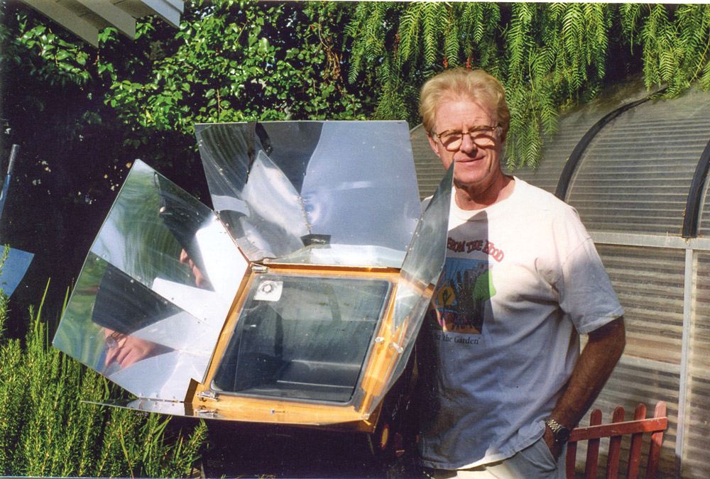 Actor Ed Begley Jr. poses with his solar-powered Sun Oven in his backyard.