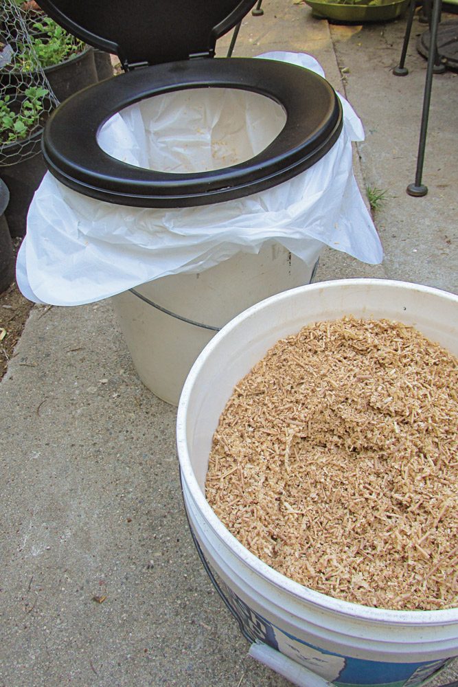 Wood chips or shavings are ideal to add to the toilet after each use.