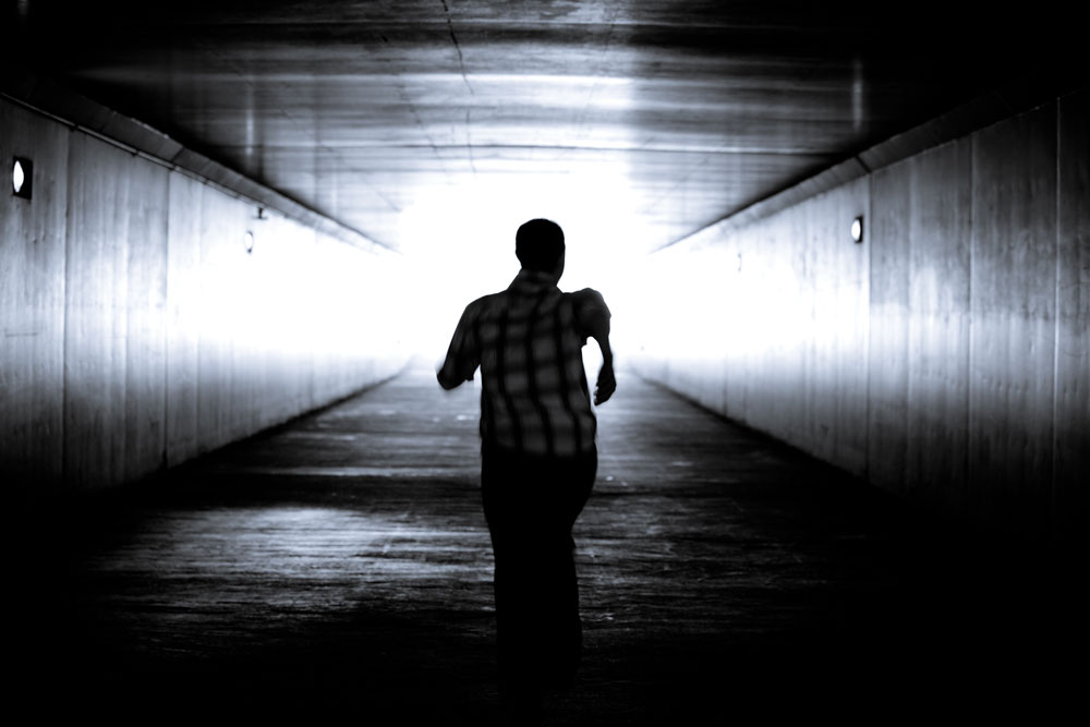 One symptom of nyctophobia is the person's desperate need to escape from the darkness.