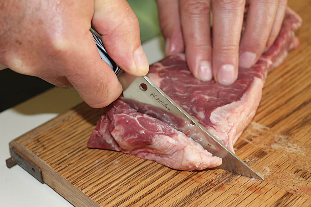 The author tested Bow River fixed blade's cutting ability on a beefsteak.