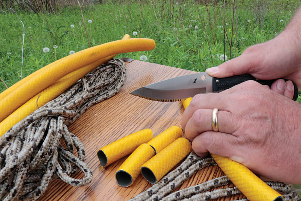 The Jumpmaster 2's fully serrated edge gives it great cutting power for such a lightweight knife. It cut easily through rope and rubber hose sections.