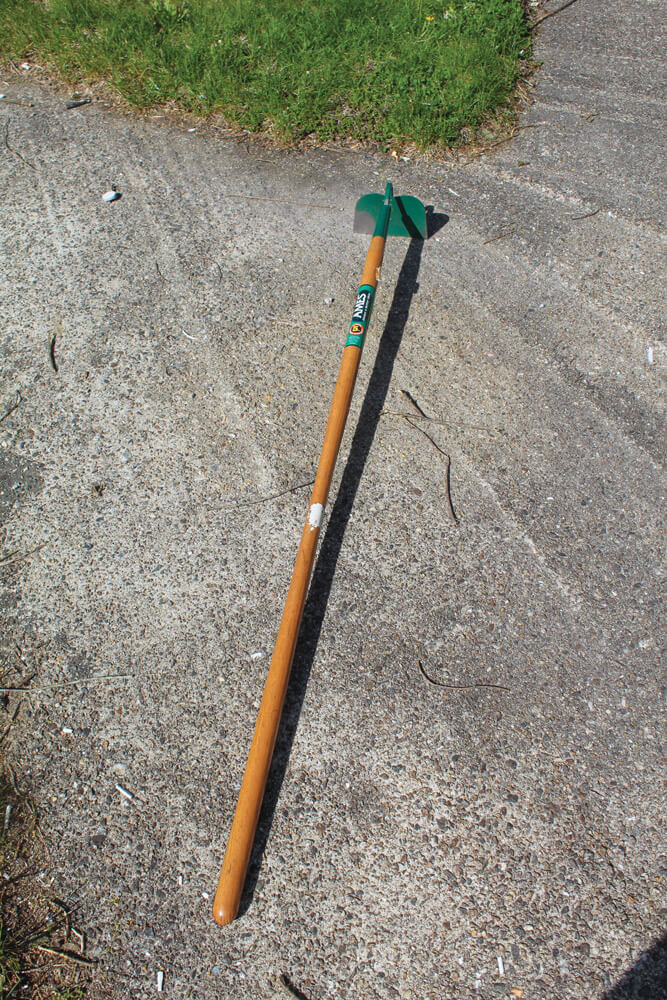A long handled garden hoe is great for weeding the rows between crops and working the soil around plants.