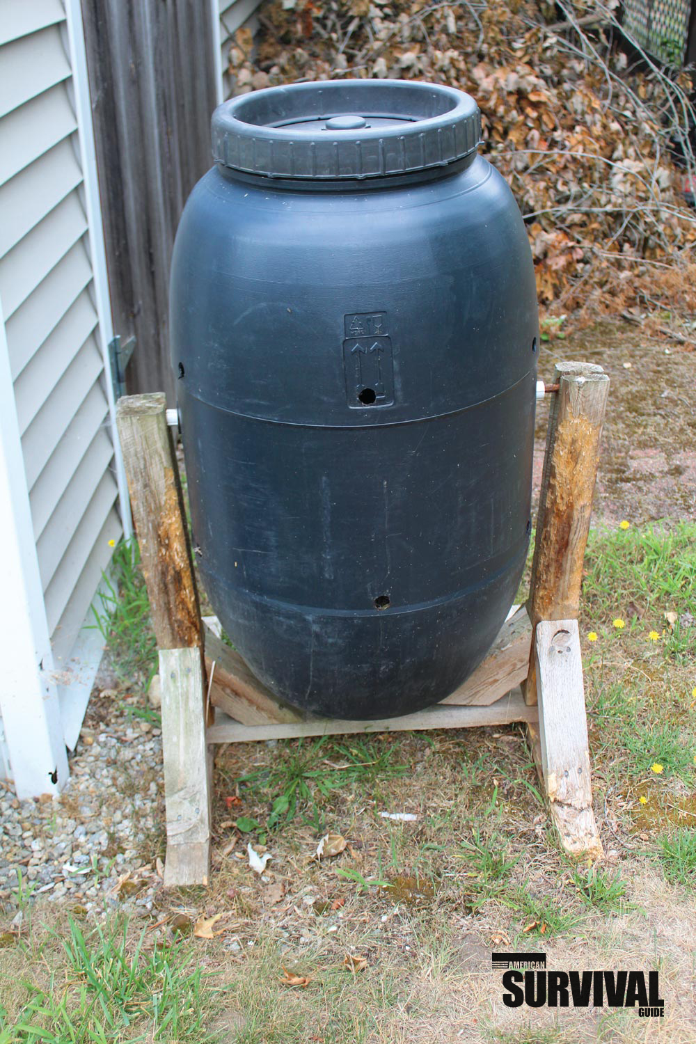 A barrel and some scrap wood can make a good compost bin. Compost will keep your garden healthy.